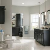KraftMaid dark cabinetry in this minimalist bath.jpg